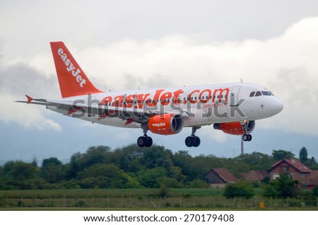 ZAGREB, CROATIA - JULY12, 2014: EasyJet Airbus A319 landing in Zagreb Pleso airport on a cloudy day - stock photo