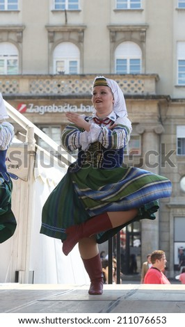ZAGREB, CROATIA - JULY 18: Folk group Selkirk, Manitoba, Ukrainian Dance Ensemble Troyanda from Canada during the 48th International Folklore Festival in center of Zagreb, Croatia on July 18, 2014