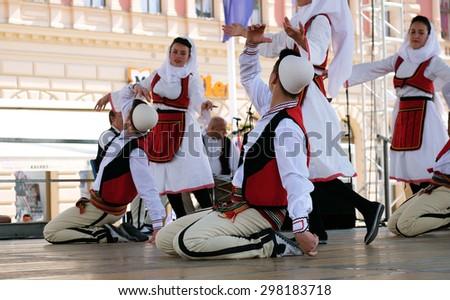 ZAGREB, CROATIA - JULY 19: Members of folk group Deshmoret e Kombit from Pristina, Kosovo during the 49th International Folklore Festival in center of Zagreb, Croatia on July 19, 2015 - stock photo