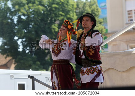 ZAGREB, CROATIA - JULY 17: Members of folk group Edmonton (Alberta), Ukrainian dancers Viter from Canada during the 48th International Folklore Festival in center of Zagreb,Croatia on July 17, 2014