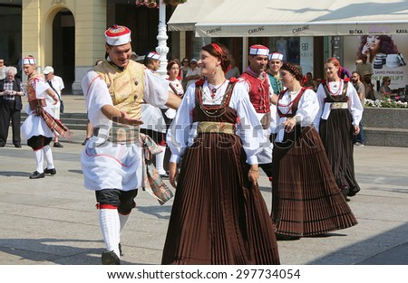 ZAGREB, CROATIA - JULY 18: Members of folk group Kumpanjija from Blato, island of Korcula, Croatia during the 49th International Folklore Festival in center of Zagreb, Croatia on July 18, 2015