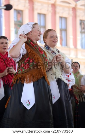 ZAGREB, CROATIA - JULY 19: Members of folk group Selacka Sloga from Nedelisce, Croatia during the 48th International Folklore Festival in center of Zagreb,Croatia on July 19, 2014
