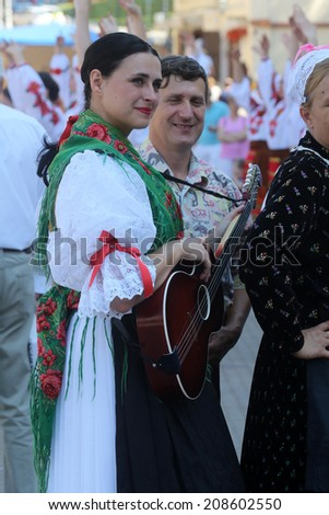 ZAGREB, CROATIA - JULY 16: Members of folk groups from Mihovljan, Croatia during the 48th International Folklore Festival in center of Zagreb,Croatia on July 16, 2014