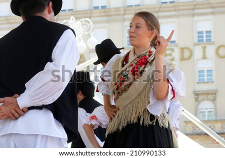 ZAGREB, CROATIA - JULY 20: Members of folk groups from Sveta Marija, Croatia during the 48th International Folklore Festival in center of Zagreb, Croatia on July 20, 2014