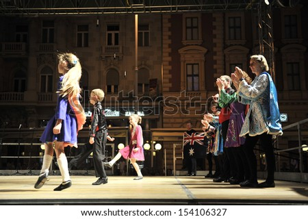 ZAGREB,CROATIA - JULY 18: Members of folk groups O'Shea-Ryan Irish Dancers from Australia during the 47th International Folklore Festival in center of Zagreb,Croatia on July 18,2013