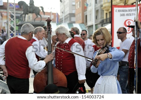 ZAGREB,CROATIA - JULY 19: Members of folk groups Santa Gorizia from Italy during the 47th International Folklore Festival in center of Zagreb,Croatia on July 19,2013