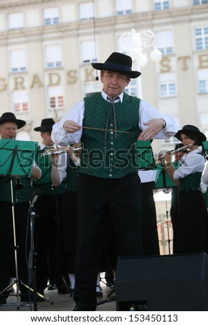 ZAGREB,CROATIA - JULY 19: Members of Music Society Sacilia from Schemmerberg in German national costume during the 47th International Folklore Festival in center of Zagreb, Croatia on July 19,2013