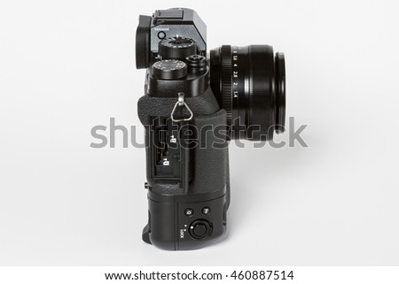 ZAGREB, CROATIA   JULY 30,2016: Photo of FUJIFILM X-T2, 24 megapixels, 4K video mirrorless camera with open conector doors on white background