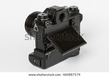 ZAGREB, CROATIA   JULY 30,2016: Photo of FUJIFILM X-T2, 24 megapixels mirrorless camera With 35mm FUJINON LENS with an additional battery grip and with tilted rear screen from back on white background