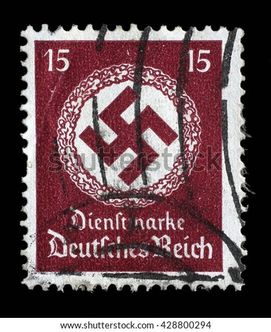 ZAGREB, CROATIA JUNE 22: A postage stamp printed in Germany shows the Swastika in an oak wreath, circa 1942, on June 22, 2014, Zagreb, Croatia - stock photo