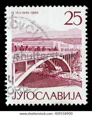 ZAGREB, CROATIA - JUNE 14: A stamp printed by Yugoslavia shows Titograd(Podgorica), The 20th Anniversary of Liberation issue, circa 1965, on June 14, 2014, Zagreb, Croatia - stock photo