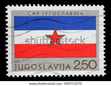 ZAGREB, CROATIA - JUNE 14: A stamp printed by Yugoslavia shows Yugoslav flag, Republic Day issue, circa 1980, on June 14, 2014, Zagreb, Croatia - stock photo