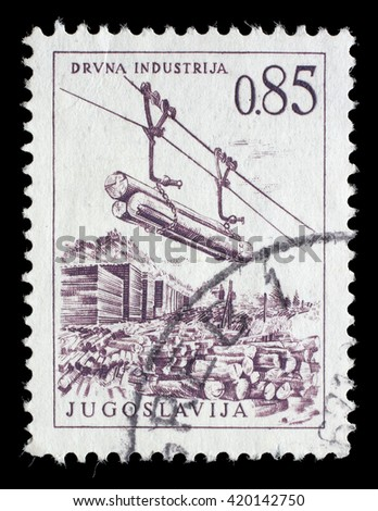 ZAGREB, CROATIA - JUNE 14: A stamp printed in Yugoslavia shows lumber industry, circa 1966, on June 14, 2014, Zagreb, Croatia - stock photo