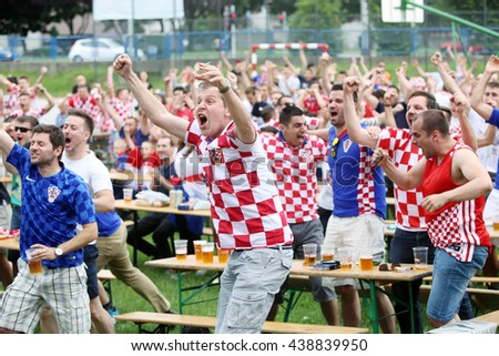ZAGREB,CROATIA - JUNE 17,2016 : Croatian football fans on the playground at Jarun, watching EURO 2016 match Czech Republic vs Croatia in Zagreb,Croatia.Fans celebrate a goal that is scored by Croatia. - stock photo