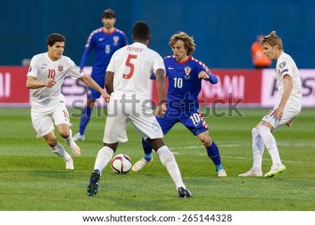 ZAGREB, CROATIA - MARCH 28, 2015: EURO 2016 qualifiers, group H - Croatia VS Norway. Luka MODRIC (10) between Norwegian players. - stock photo
