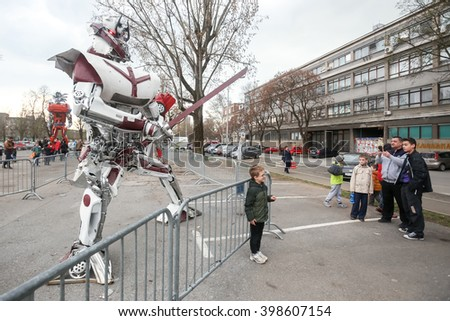 ZAGREB, CROATIA - MARCH 26, 2016 : Exhibition by Danilo Baletic (23) named Transformers protecting Zagreb on square Franje Tudjmana in Zagreb,Croatia. Exhibition is made of automobile parts and waste. - stock photo