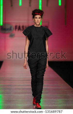 ZAGREB, CROATIA - MARCH 15: Fashion model on catwalk wearing clothes designed by Morana Krklec on the 'Fashion.hr' show on March 15, 2013 in Zagreb, Croatia.