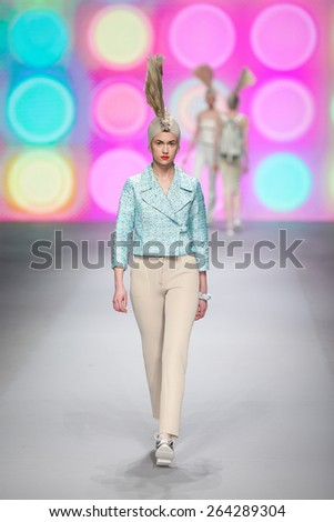 ZAGREB, CROATIA - MARCH 21, 2015: Fashion model wearing clothes designed by 'BiteMyStyle by Zoran Aragovi?' on the 'Fashion.hr' fashion show - stock photo