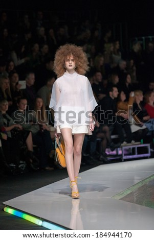 ZAGREB, CROATIA - MARCH 28, 2014: Fashion model wearing clothes designed by Marina Design and Marija Ivanovic bag on the 'Fashion.hr' fashion show - stock photo