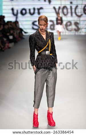 ZAGREB, CROATIA - MARCH 21, 2015: Fashion model wearing clothes designed by Marina Design on the 'Fashion.hr' fashion show - stock photo
