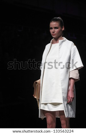 "ZAGREB, CROATIA - MARCH 13: Fashion model wears clothes made by Aleksandra Dojcinovic on ""PERWOLL FASHION.HR"" show on March 13, 2013 in Zagreb, Croatia."