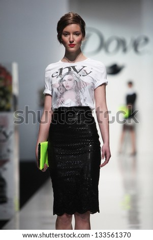 "ZAGREB, CROATIA - MARCH 15: Fashion model wears clothes made by eNVy Room on ""PERWOLL FASHION.HR"" show on March 15, 2013 in Zagreb, Croatia."