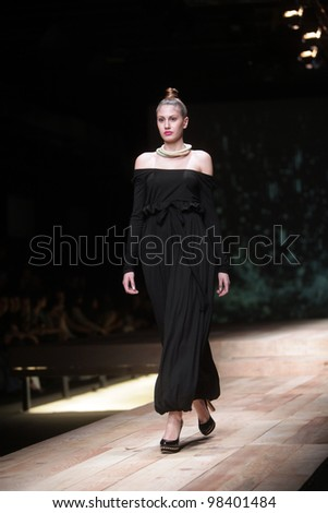 "ZAGREB, CROATIA - MARCH 22: Fashion model wears clothes made by Sonja Lamut on ""CRO A PORTER"" show on March 22, 2012 in Zagreb, Croatia."