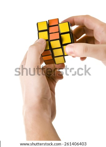 ZAGREB, CROATIA - MARCH 13, 2015: Hands solving Rubik's Cube. Rubik's Cube is invented by Erno Rubik in 1974. He is a Hungarian inventor, architect and professor of architecture.