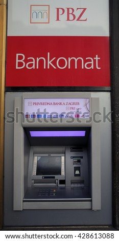 ZAGREB, CROATIA - MAY 26, 2016: A PBZ ATM machine. Privredna banka Zagreb or PBZ is the second largest bank in Croatia, owned by Intesa Sanpaolo group of Italy   - stock photo