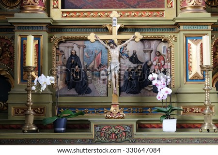 ZAGREB, CROATIA - MAY 28: Cross on the altar in the Basilica of the Sacred Heart of Jesus in Zagreb, Croatia on May 28, 2015 - stock photo