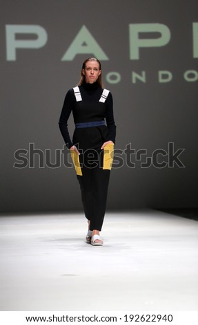 ZAGREB, CROATIA - MAY 09: Fashion model wearing clothes designed by Paper London on the Zagreb Fashion Week on May 09, 2014 in Zagreb, Croatia.