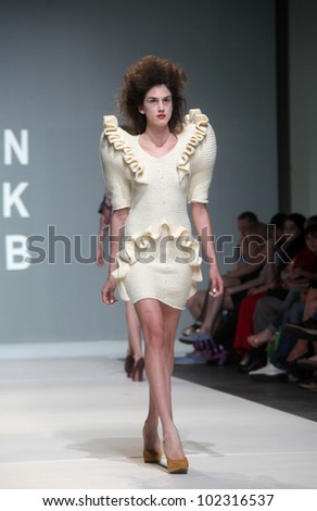"ZAGREB, CROATIA - MAY 10: Fashion model wears clothes made by Leandro Cano on ""ZAGREB FASHION WEEK"" show on May 10, 2012 in Zagreb, Croatia."