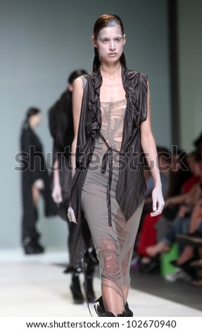 "ZAGREB, CROATIA - MAY 10: Fashion model wears clothes made by Rannva Karadottir & Marianna Morkore on ""ZAGREB FASHION WEEK"" show on May 10, 2012 in Zagreb, Croatia."
