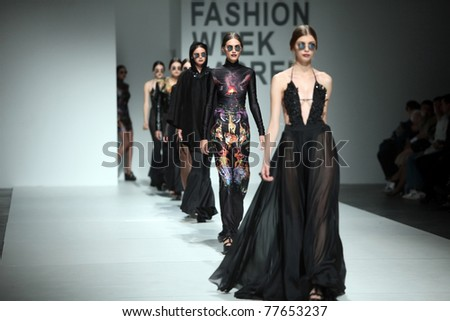 ZAGREB, CROATIA - MAY 19: Fashion models wear clothes made by Maria Escote in 'Fashion Week' show on May 19, 2011 in Zagreb, Croatia. - stock photo