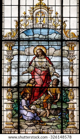 ZAGREB, CROATIA - MAY 28: Jesus friend of the children, stained glass window in the Basilica of the Sacred Heart of Jesus in Zagreb, Croatia on May 28, 2015 - stock photo