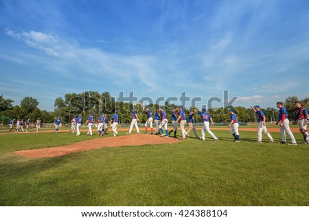 ZAGREB, CROATIA - MAY 22, 2016: Match between Baseball Club Zagreb vs. Aeros Erd. Players congratulate each other