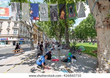 ZAGREB, CROATIA - MAY 26, 2016:  20th Cest is d'Best international street festival in Zrinjevac park, Artists drawing with chalk