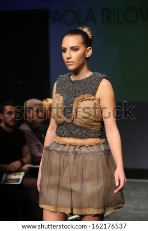 ZAGREB, CROATIA - NOVEMBER 07: Fashion model wearing clothes designed by Radetic and Topalovic on the Fashion Wardrobe show on November 07, 2013 in Zagreb, Croatia.