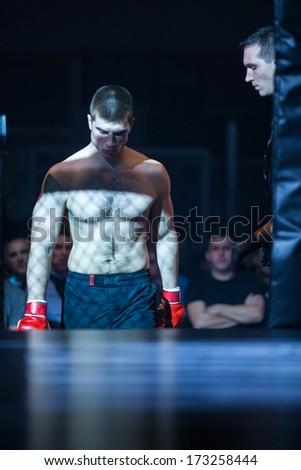 ZAGREB, CROATIA - NOVEMBER 2, 2013: Final fights at Croatian MMA legaue. Matej BATINIC (red gloves) entering the cage. - stock photo