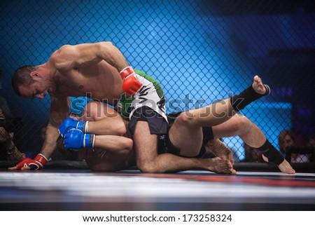 ZAGREB, CROATIA - NOVEMBER 2, 2013: Final fights at Croatian MMA legaue. Peter BULJAn (red gloves) VS Kristijan SVRTAN (blue gloves). - stock photo