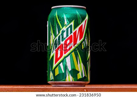 ZAGREB , CROATIA - NOVEMBER 19 ,2014 :   Mountain Dew can splashed with water on black background, product shot - stock photo