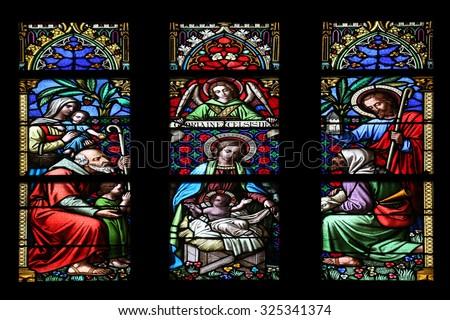 ZAGREB, CROATIA - NOVEMBER 21: Nativity Scene, Adoration of the Shepherds, stained glass window in parish church of Saint Mark in Zagreb, Croatia on November 21, 2014 - stock photo