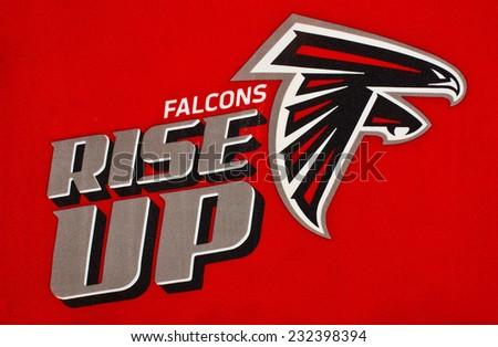 ZAGREB , CROATIA - NOVEMBER 22 , 2014 :  NFL Atlanta Falcons logo printed on flag with team moto ,product shot - stock photo