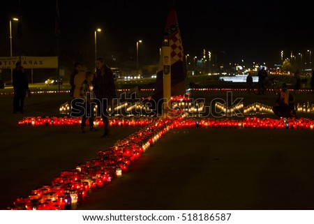 ZAGREB, CROATIA - NOVEMBER 18, 2016. - People in Zagreb lightning candles next to Vukovarska avenue in memory of in homeland war destroyed croatian city Vukovar.