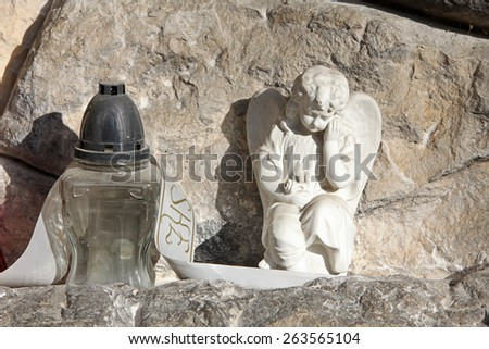 ZAGREB, CROATIA - OCTOBER 28: A white mourning porcelain angel on a Mirogoj cemetery in Zagreb, Croatia on October 28, 2013. - stock photo