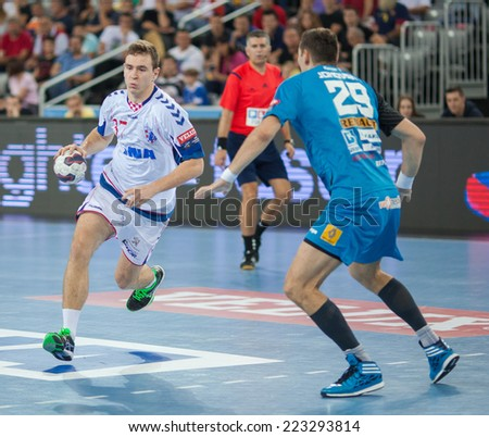 ZAGREB, CROATIA - OCTOBER 11, 2014: EHF Men's Champions League, match between HC Zagreb and HC Metalurg. Sandro OBRANOVIC (37) and Ace JONOVSKI (29).