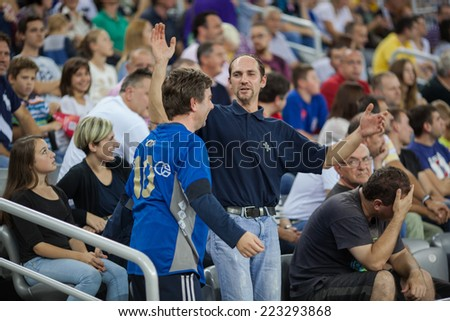 ZAGREB, CROATIA - OCTOBER 11, 2014: EHF Men's Champions League, match between HC Zagreb and HC Metalurg. Zagreb's fans on celebrating on stands.