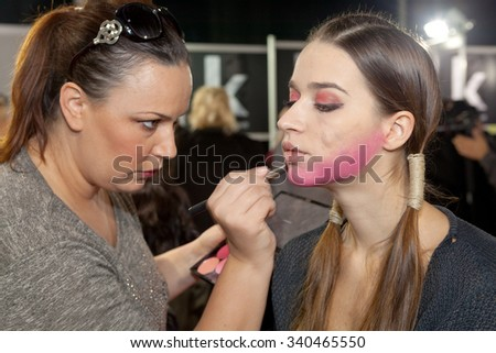 ZAGREB, CROATIA - OCTOBER 31, 2015: Fashion model undergoing makeup process in backstage for Couture show by Marina Design on the 'Fashion.hr' fashion show - stock photo