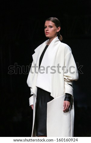 ZAGREB, CROATIA - OCTOBER 24: Fashion model wearing clothes designed by Arielo on the Cro a Porter show on October 24, 2013 in Zagreb, Croatia.