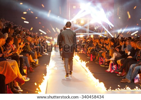 ZAGREB, CROATIA - OCTOBER 31, 2015: Fashion model wearing clothes designed by IK Studio on the 'Fashion.hr' fashion show, with catwalk on fire